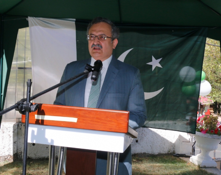 Ambassador of Pakistan addressing guests at the flag hoisting ceremony
